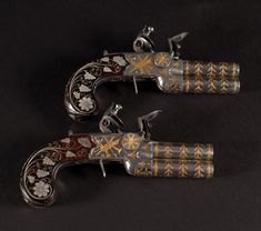 View 1: Possibly the Finest Pair of English Gold and Silver Inlaid Flintlock Over and Under Pocket Pistols on the market today! Made by John Brown of London circa 1800-1810, this elaborate pair of gold and silver inlaid flintlock tap action pocket pistols appear to be in virtually 'as new' condition with only minor wear.