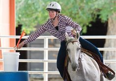 Jayce Ervin and her horse Sue take part in the flag racing portion of the gymkhana competition Sunday at the Pueblo County Fair. Ervin logged a 10.844 in the event. (Chieftain photo by Mike Sweeney, July 8, 2012)