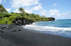 Black sand beach on the road to Hana (Maui, Hawaii). Beautiful scenery but I thought I was going to throw up on the road to Hana!!! :)
