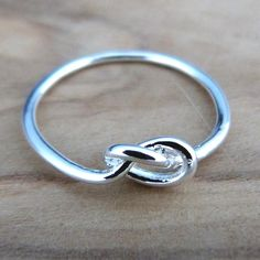 You've got the dress, you've got the rings but there's one thing missing.. Gifts for your gorgeous bridesmaids!  This classic infinity knot ring makesa bridesmaid present! Thank you for helping us tie the knot... Also available in gold!  Bridesmaid present ideas blog - http://beunique-jewellery.blogspot.co.uk/