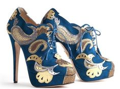 Every girl should have a pair of ridiculously over-the-top shoes...talk about wow factor!