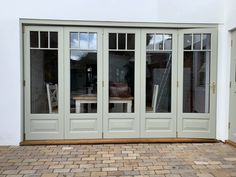 Accoya Bifold doors manufactured by Medina Joinery, painted in Farrow & Ball French Grey Wooden Bifold Doors, Bifold French Doors, Bifold Exterior Doors, Sliding Doors, Garage Door Paint, Painting Garage Doors, French Doors Bedroom, House Extension Design, French Exterior