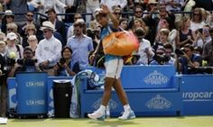Rafael Nadal waves to the crowd as he leaves the court after losing to Alexandr Dolgopolov.