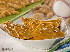 We're saluting the All-American sport of baseball with our recipe for Old-Fashioned Peanut Brittle. In fact, we think this easy peanut candy is sure to be a real