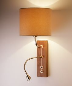 Domino - Bedside wall and reading light. Wooden back panel features maple with walnut inlay or reverse. LED reading light can be specified as either a flexible arm or short adjustable head.