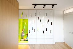 Marvellous home remodel interior ideas of connaught resident featuring modern stylish colorful kidroom with woodhard floor corridor lighted by black spot lamp ceiling laminated wall.jpg