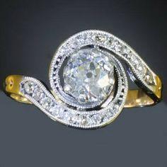 Victorian tourbillon engagement ring with big brilliant old mine cut diamond