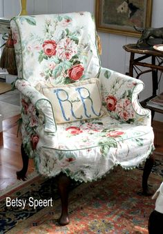 pretty slipcovered chair in floral with the , love the sweet scallop edge and trim.  perfect for a shabby chic bedroom or even bathroom  :)