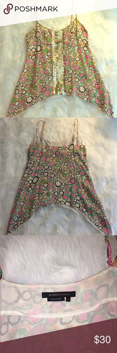 BCBGMAXAZRIA Aline silk camisole This is gorgeous 100% silk camisole. Size is small. I only wore once or twice and was sleeping in my closet. This Aline camisole make fluttering movement when you walk! This camisole is just so beautiful✨ dress up or down, this goes with any ways!  From smoke free pet free home :)  Feel free to make an offer! BCBGMaxAzria Tops Camisoles