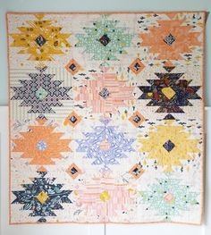 Looking for your next project? You're going to love Wild Blooms modern aztec quilt pattern by designer QuiltStory.