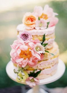 Yummy pink layered wedding cake with the prettiest flowers; Featured Photographer: Jessica Gold Photography