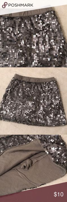 Girls silver/gray sequin skirt Girls silver/gray sequin skirt. Has shorts made in underneath so perfect for summer!! Size 6-7. Perfect condition and smoke free home Old Navy Bottoms Skirts