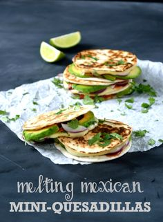 Melting Mexican Mini-Quesadillas- These bite-sized quesadillas are filled with avocado, red onion, tomato salsa and fresh coriander, and topped with oozing swiss cheese. | The Veg Space #vegetarian