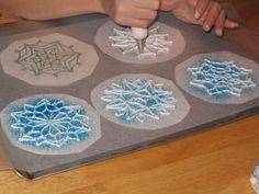 Dreaming Wedding Cake:   Blue and white Snowflake Garnish recipe.  Draw snowflakes on wax paper, then tape to a cookie sheet and cover with second layer wax paper. Using a #3 decorating tip, pipe royal icing or melted white chocolate over each pattern, then sprinkled it with edible glitter (clear, silver, or blue).
