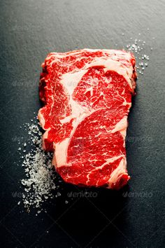 Raw beef steak by klenova. Raw beef steak on a dark slate background Raw beef steak by klenova. Raw beef steak on a dark slate background Raw Food Recipes, Meat Recipes, Meat Steak, Dark Food Photography, Photography Photos, Meat Lovers, Steaks, Food Design, Charcuterie