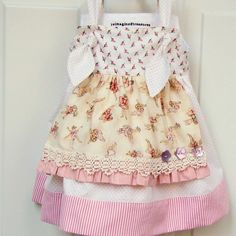 put this apron and buttons on a onesie