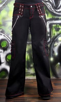From Tripp NYC  Girls bondage pants feature red contrast stitching,detachable metal chains, metal eyelets, and various d-rings!   Adjustable buckles on the sides of the waist to adjust the fit.