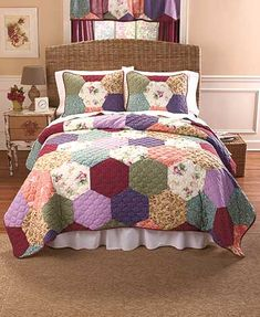 """Transform your entire bedroom with a colorful, coordinated Emma Patchwork Quilt Ensemble. Cover your bed with the Full/Queen Quilt (86"""" sq.) or King Quilt (100"""""""