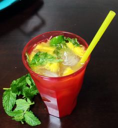 Coconut mango mojito: Muddle fresh mint (8-10 leaves), one teaspoon stevia, 1/4 cup fresh mango, and juice of half a lime.  Add equal parts Parrot Bay 90 proof coconut rum, sour mix, and sprite.  Shake well and pour over ice.  Can be made in bigger batches for parties!