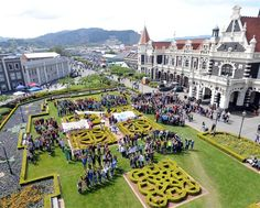 350 is spelled out in front of the Dunedin Railway Station by people visiting the Spring Food Festival, which was organised as one of the Nz South Island, New Zealand South Island, The Places Youll Go, Places To See, Dunedin New Zealand, Florida City, Climate Action, British Isles, Auckland