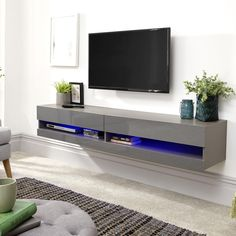 Abril wall mounted large TV wall unit in grey gloss with led, will simply amaze your guests with it's stunning look and design - 38887 shop modern & contemporary white high gloss TV stands, TV units, cabinets & wall entertainment. Modern Tv Cabinet, Tv Cabinet Design, Tv Wall Design, Tv Wall Unit Designs, Modern Tv Wall Units, Living Room Tv Unit Designs, Tv Escondida, Wall Mounted Tv Unit, Mounted Tv Decor