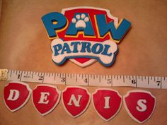Personalised Paw Patrol badge sugar paste icing cake topper edible birthday Decoration Ideal for Birthday. aw Patrol badge is 4 x 2,7 Material: colors,sugar paste If you purchased Paw Patrol badge and badges with name please send me message for name you require. EDIBLE Shelf life: 6 months (keep in a cool dry place) do not refrigerate https://www.facebook.com/homemade.CAKES.Torquay/ Thanks for Watching ! : )