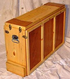 Scouter Hugh McVeigh in Germnantown Tennessee has designed a handsome, functional variation called the Kamp Kitchen. He first built them with his sons (both Eagle Scouts) and has built around 100 to date including some for the 1993 National Jamboree. See more pictures and read about the project at Chuck Box Kitchen.