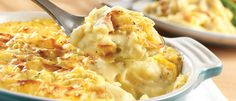 Savory mashed potatoes are laced with a cheddar cheese sauce, sour cream and green onion. Baked to a golden turn, this dish is a real crowd pleaser.