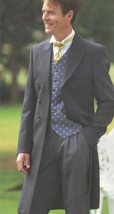 Google Image Result for http://www.iamstaggered.com/wp-content/uploads/2010/07/suits-victorian-frock-coat.jpg