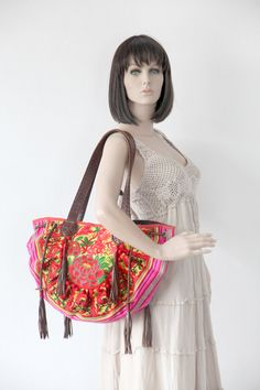 This amazing Shoulder Bag showcases a beautiful piece of embroidered fabric woven by the HMONG hill tribes of Lanna Country (Northern Thailand). It