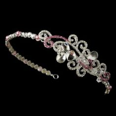 "A modern twist on a vintage-inspired tiara, this piece boasts an artistic arrangement of pink faux pearls, stunning rhinestones, and lovely swarovski crystals. The side ornament measures 4"" wide and 1-1/2"" tall, and the entire band, decorated with alternating faux pearls and rhinestones, measures 13"" wide and 1/4"" tall.  Size: 13"" wide and 1/4"" tall"
