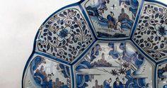 Ein Frankfurter Fayence-Teller - Fayence: französisch, von der italien. Stadt Faenza abgeleitet, Keramik mit porösem Scherben, die mit einer weissen oder farbigen Zinnglasur überzogen ist, mit Unterglasur- oder Muffelfarben bemalt und mehrmals gebrannt wird.