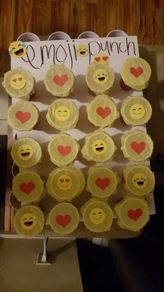 EMOJI punch board....solo cups glued to foam board filled with goodies...tissue paper glued to close cup...kids punch with hand for prizes