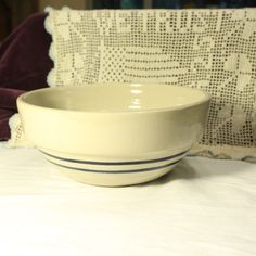 A personal favorite from my Etsy shop https://www.etsy.com/listing/495726435/vintage-yellow-ware-bowl-2-navy-blue