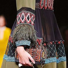 It's all about the detail at #Valentino, with delicate feather cuffs, a luxe mix of fabrics and the new mini bag.