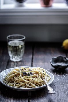 A simple combination of spaghetti with black truffle, parmigiano and lemon. Recipe for Spaghetti with Black Truffle, Parmigiano and Lemon | Anisa Sabet | The Macadames | Food Styling | Food Photography | Props | Moody | Food Blogger | Recipes