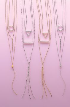 Layering sparkly jewelry this season   Nadri pendant necklaces.