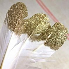 Make these beautiful glitter-tipped feathers for use as place-settings, in garlands, as gift tags or a myriad of other uses!