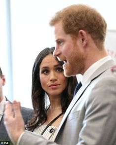 The bride-to-be listened intently as Harry chatted to delegates