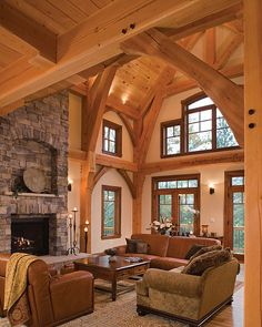 Elegant arches frame the great room as large windows allow natural light to accent the room's décor. Timber Frame Homes, Timber House, Log Cabin Homes, Log Cabins, Stone Houses, My Dream Home, Great Rooms, Beautiful Homes, House Plans