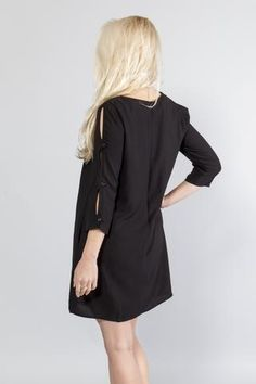 Trending, Cute, Sexy Black Mini Shift Dress Round neck Three-quarter sleeves with slit button detail  Side pockets Concealed back zipper Lined