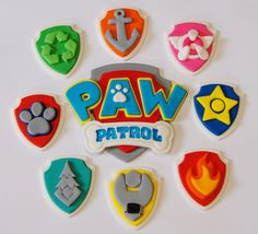 PAW PATROL CUP CAKE TOPPERS X 12 **WITH PAW PATROL LOGO CENTRE PIECE**