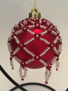 This silver and red ornament cover will be a beautiful addition to your Christmas tree this year, and in the years to come. An ideal gift for Christmas lovers. Fits 18cm 7 circumference bauble/ornament. Ships Worldwide from the UK. Baubles not included, cover only. Please keep