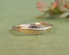 Small and Delicate Feather Ring Material: High Quality 14K Yellow Gold Plated over Brass Width: 4mm; 0.15 Each ring can be enlarged in ¼ of a…
