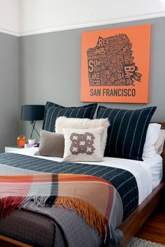 This modern bachelor pad designed by San Francisco interior designer Regan Baker really hits al...