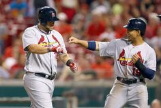 Matt Adams celebrates with Jon Jay after hitting a three run home run in the 9th inning during the game against the Cincinnati Reds. Cards won 5-0.  9-08-14