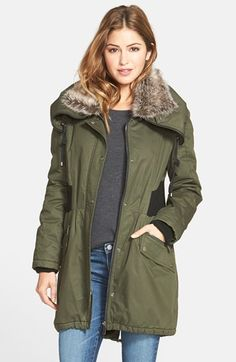 Free shipping and returns on DKNY Faux Fur Trim Utility Parka at Nordstrom.com. A detachable faux-fur collar wraps the neck in plush softness atop a warm, anorak-style parka with a rugged cotton twill shell. Rib-knit storm cuffs and drawstrings to cinch the collar and drop-tail hem help keep out the chill, while contrast knit side panels nip in the waist.