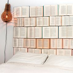 An easy DIY headboard made of thrifted vintage books.