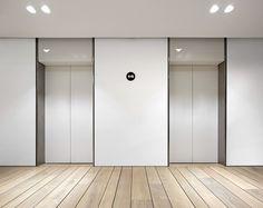 14 + elevators + white plank wood floors + subtle pattern