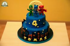 Amazing 3 tier PJ Masks birthday cake - love the details on each.